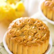 Assorted fruits nuts mooncakes on table — Stock Photo