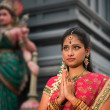 Young Indian woman praying — Stockfoto