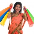 Indian woman in sari dress holding shopping bags — Stock Photo #30152859