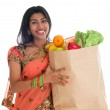 Indian woman having groceries shopping — Stock Photo