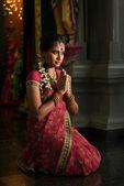 Indian woman praying — Stock Photo