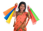 Indian woman in sari dress holding shopping bags — Stock Photo