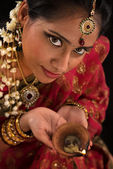 Diwali Indian female with oil lamp — Stock Photo