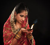 Diwali Indian woman with oil lamp — Stock Photo