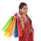 Happy Indian woman shopping — Stock Photo