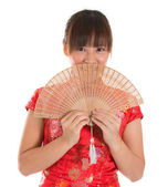 Chinese cheongsam female with fan — Stok fotoğraf