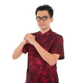 Chinese cheongsam male greeting — Stock Photo