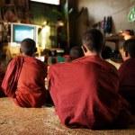Buddhist monks enjoying tv show — Stock Photo #30967229