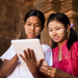 Myanmar girl using digital tablet pc — Stock Photo