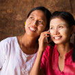 Two Myanmar girls using smart phone. — Stock Photo