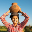 Asian traditional female farmer carrying clay pot — Stock Photo