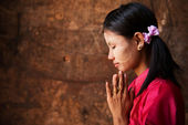 Myanmar girl in a praying pose. — Stock Photo