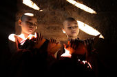 Two Southeast Asian little monks reading book — Stock Photo