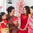 Asian family celebrate Chinese new year at home. — Stockfoto