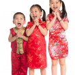 Little Asian children wishing you a happy Chinese New Year — Stock Photo