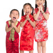 Group of oriental children wishing you a happy Chinese New Year — Stock Photo