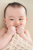 Teething Asian baby girl — Stock Photo