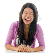 Candid Asian woman laughing — Stock Photo