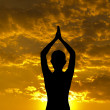 Silhouette yoga pose — Stock Photo