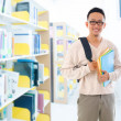 Southeast Asian adult student in library — Stockfoto