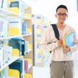 Southeast Asian adult student in library — Foto Stock