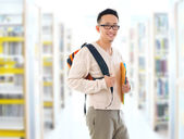 Asian adult student in library — Stock Photo
