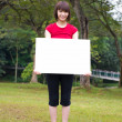 Asian girl holding a placard outdoor — Stock Photo