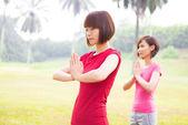 Asian girls yoga at outdoor — Stock Photo