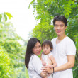 Happy Asian family outdoor portrait. — Stock Photo #38847835