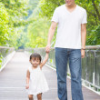 Stock Photo: Father and daughter holding hands walking