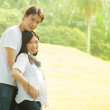 Happy young pregnant Asian couple — Stock Photo