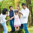 Happy Indian family outdoor fun — Stock Photo #38847995