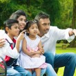 Happy Indian family at outside — Stock Photo #38848021