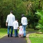 Happy Indian family walking outdoor — Stock Photo
