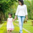 Indian mother and daughter walking outdoor. — Stock Photo