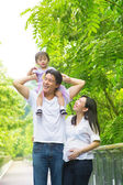 Happy Asian family outdoor fun. — Stock Photo