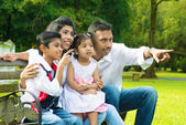 Happy Indian family at outside — Stock Photo