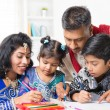Indian family painting picture at home — Stock Photo