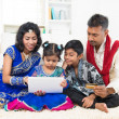 Stock Photo: Indian family online shopping