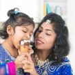 Eating ice cream with mother — Stock Photo #41776189