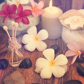 Spa treatment setting with frangipani — Stock Photo