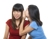 Whispering to ear — Stock Photo