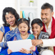 Indian family using digital computer tablet — Stock Photo #46721551