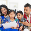 Indian Asian family online shopping — Stock Photo