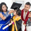 Kindergarten graduation with family — Stock Photo