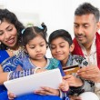 Indian Asian family online shopping with credit card — Stock Photo #46721561