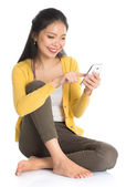 Asian female texting — Stock Photo