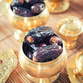 Dates fruit or kurma in metal bowl. — Stock Photo