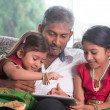 Indian family using tablet computer. — Stock Photo #47663357