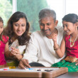 Happy Indian family playing carrom game — Stock Photo #47663401